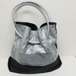 Silver and black bejeweled bucket bag.
